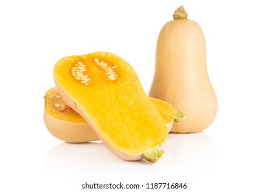 Group of one whole two halves of smooth pear shaped orange butternut squash waltham variety with seeds isolated on white background