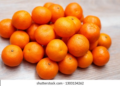 Group of orange clementine on wood table top view