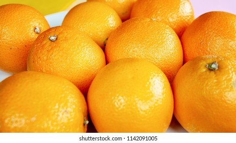 group of oranges on a white plate