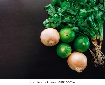 group organic fresh coriander , cilantro , onion and lime are ingredient of asia food on wood table kitchen background