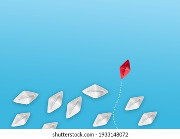 Group of origami boats on blue. One red paper boat with a group of white boats on blue. Team work concept