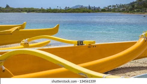 Group of outrigger canoes at edge of Maunalua Bay with Diamond Head in the distance, Oahu, Hawaii