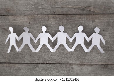 group of paper people holding hands