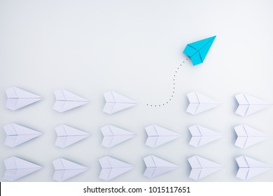 Group of paper planes in one direction and with one individual pointing in the different way. Business concept for innovative solution.