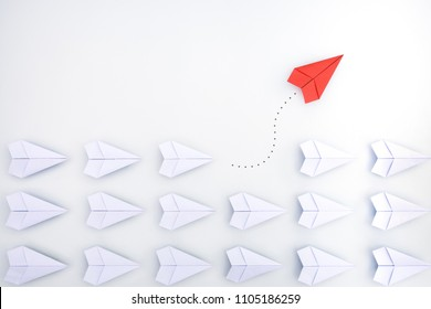 Group of paper planes in one direction and with one individual pointing in the different way. Business for innovative solution concept.