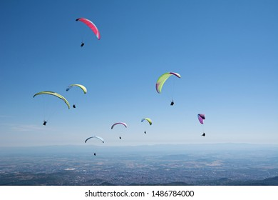 Group of paragliders enjoy a thermal updraft in Puy de Dome, Auvergne, French Massif Central. France