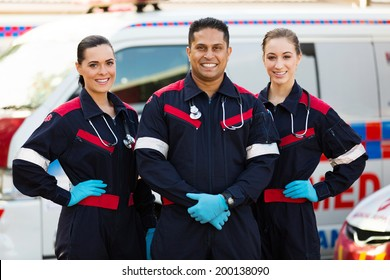 group of paramedics standing in front of an ambulance