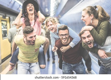 Group of party friends having fun in underground metropolitan station - Young people ready for night out  - Friendship and party concept - Focus on center man face