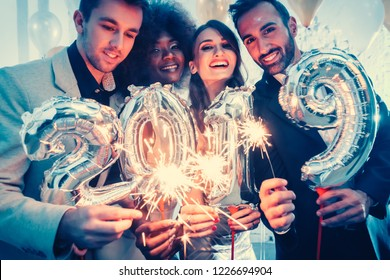 Group of party people celebrating the arrival of 2019, men and women looking into camera