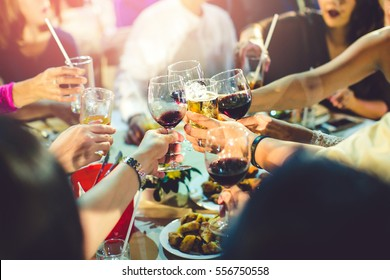 Group of partying girls clinking flutes with sparkling wine,Friend