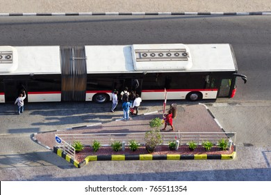 A group of passengers enters the bus.Top view.