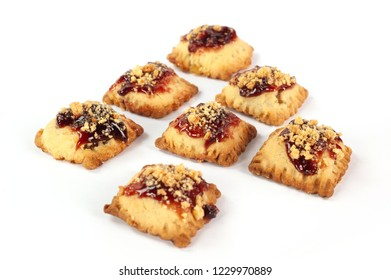 group of pastries filled with fruit and jam
