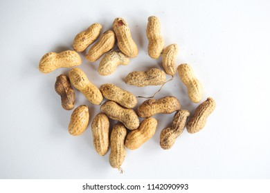 group of peanuts on a white plate