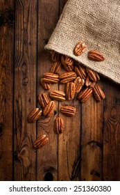 group of pecans on wooden background