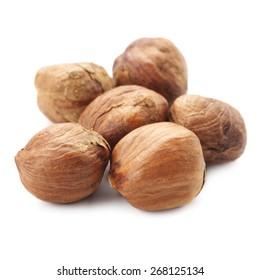 Group of peeled hazelnuts isolated on white background.