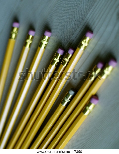 A group of pencils with the eraser showing.