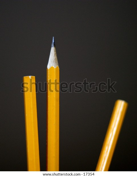 A group of pencils with the middle one sharpened.  Good for a competition image, or team image.