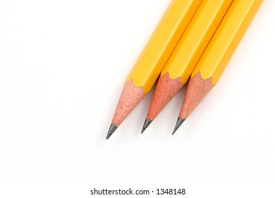 Group of pencils with sharp points over a white background.