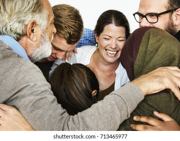 Group of people arm around support together