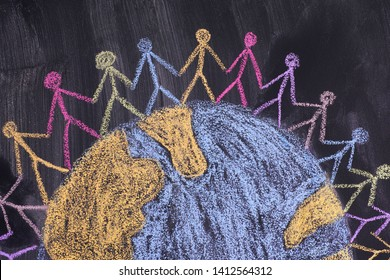 Group of people around the world. Chalk drawing. Blackboard. Close up.