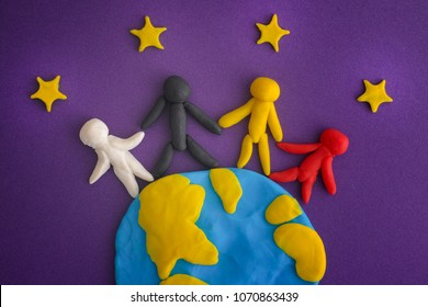 Group of people around the world. People and Earth with Stars are made out of play clay (plasticine). Close up.
