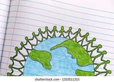 Group of people around the world holding hands on lined paper notebook sheet. Close up.