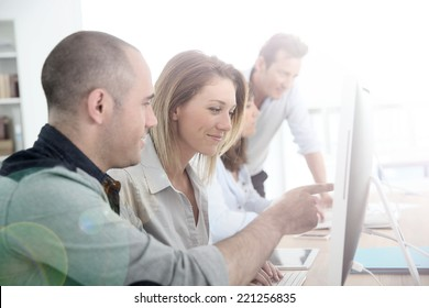 Group of people attending management training course