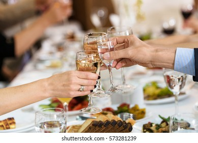 group of people in banquet hall toasting. Toasting glasses