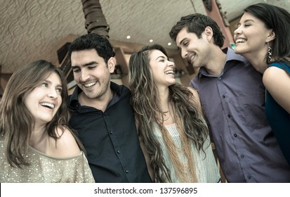 Group of people at the bar looking very happy and laughing