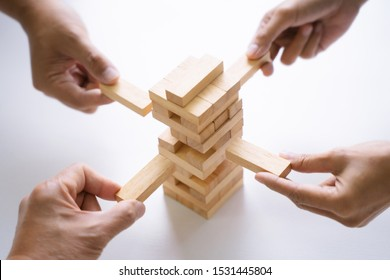 Group of people building up the tower, Business risk and strategy concept.