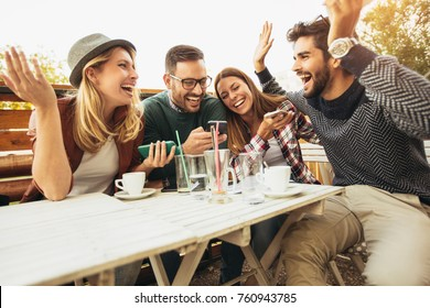 Group of people at cafe talking laughing and enjoying their time