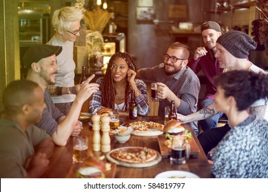 Group of people celebrate party with food
