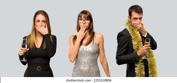 group of people with champagne celebrating new year 2019 covering mouth with hands for saying something