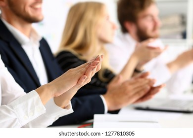 Group of people clap their arm in row during seminar closeup. Great news brief achievement win deal good job happy birthday employee introduce party positive welcome effective speech concept