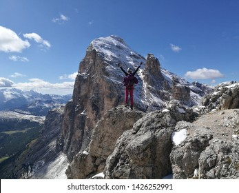Group of people climbing in the rock. Alpine climbing route ascent to summit. Adventure mountain activity