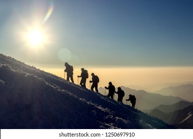 Group of people climbs the mountain Elbrus