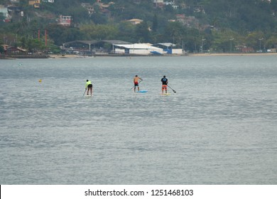 Group of people competing in Sup Paddle in Ilhabela, Brazil.