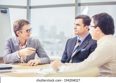 a group of people consulting Manager businessman interview