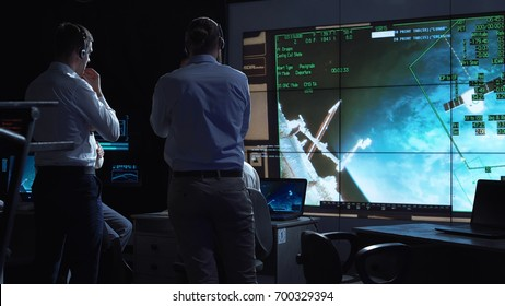 A group of people are controlling the orbiting international space station ISS. Elements of this image furnished by NASA.