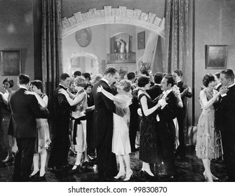 Group of people dancing in a ballroom
