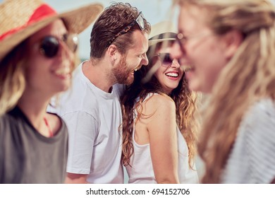 Group of people dancing at beach party