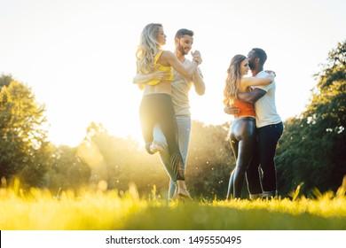 Group of people dancing Kizomba in golden sunset