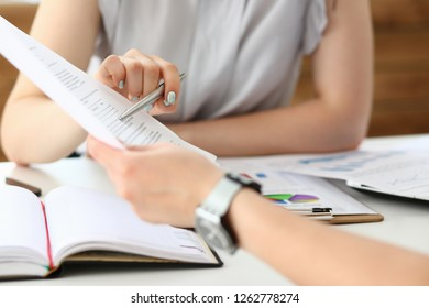 Group of people deliberate on problem with clipboard pad closeup. White collar check money papers stock exchange market earnings list partnership agreement discussion concept