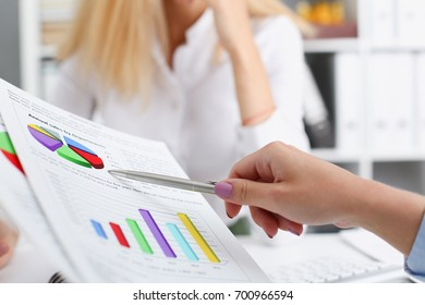 Group of people deliberate on problem with clipboard pad closeup. White collar check money papers, stock exchange market, earnings list, partnership agreement discussion or dispute concept