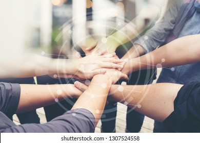 Group of People of Different NATIONALITIES, Putting H่AND Togetherness TEAMWORK or Handshake is Alliance Community Connection,BUSINESS PARTNER. TEAM Stacked with Graphic Connected Networks.