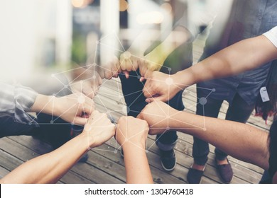 Group of People of Different Nationalities,Putting Hands Togetherness Team or Handshake is Alliance Community Connection