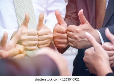 Group of people do thumbs up working together sign of O.K.