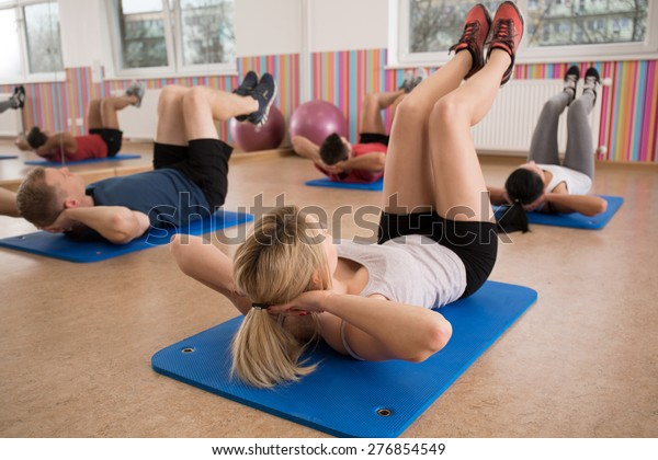 Group People Doing Crunches On Exercise Stock Photo Edit Now