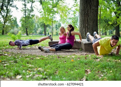 Group of people doing a outdoor workout in the park