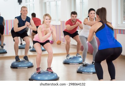 Group of people during balance training, horizontal
